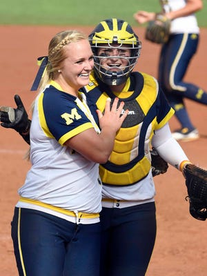Michigan pitcher Megan Betsa  celebrates with catcher Aidan Falk after beating Missouri, 5-3, in Game 1 of the Super Regional on Saturday.