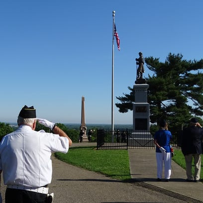 The Ross County Veterans Honor Guard salute as the