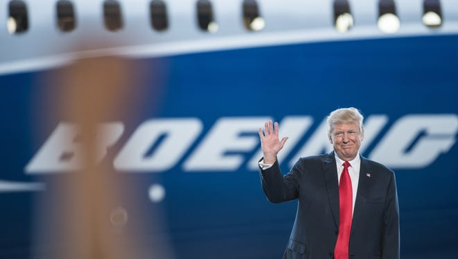 President Trump waves to a crowd Friday, during the debut event for the Dreamliner 787-10 at Boeing's South Carolina facilities.