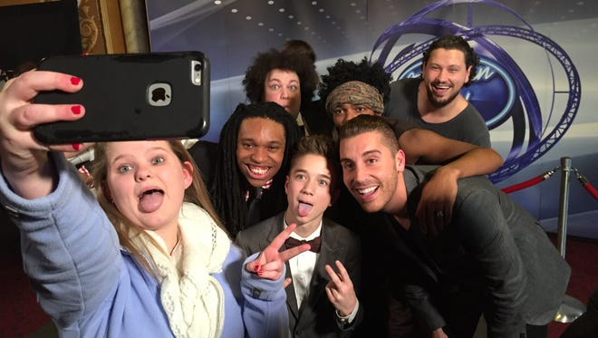 "Alexis Ayala, 15, of Chesterfield shoots a selfie with contestants from ""American Idol"" after the show's Wednesday taping at the Fillmore Detroit."
