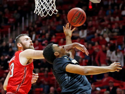 Missouri forward Jontay Porter, right, lays up the ball as Utah forward David Collette (13) defends in the first half during an NCAA college basketball game Thursday, Nov. 16, 2017, in Salt Lake City. (AP Photo/Rick Bowmer)