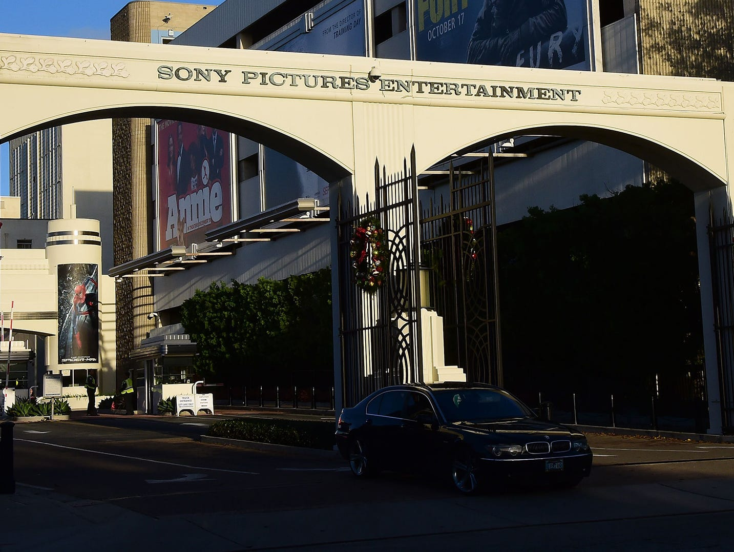 A vehicle exits Sony Pictures Entertainment in Los Angeles on Thursday, Dec. 4, 2014, a day after Sony Pictures denounced a