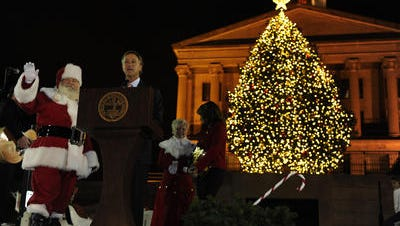 Gov. Bill Haslam and Santa at the 2012 Christmas tree lighting. Tennessee's tree is tied for 8th-tallest among statehouse Christmas trees, according to Bloomberg Politics.