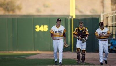 ASU's Ryan Kellogg, left, improved to 4-0 Saturday with a three-hit complete game win at Oregon.