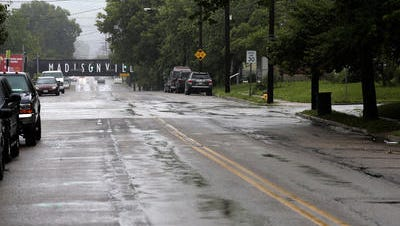 The streets were quiet Saturday morning in Madisonville, the day after Cincinnati Police Officer Sonny Kim was shot and killed near the intersection of Roe Street and Whetsel Avenue   (The Enquirer/Sam Greene)