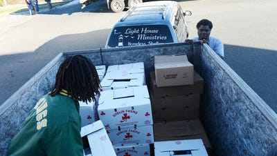In this Dec. 16, 2016 photo, Broadwater Academy's Taylor Major helps load a trailer bound for Light House Ministries homeless shelter with food on The Eastern Shore News' Bank of Cheer delivery day. Shelters around Salisbury are at capacity as frigid temperatures hover over the Eastern Shore of Maryland and Virginia.