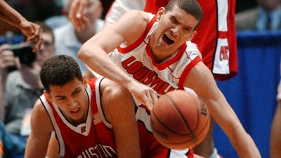 Louisville foward Francisco Garcia, top, and Austin Peay guard Rhet Wierzba (32) fall to the court while going after a loose ball during the first half of the NCAA East Regional game in Birmingham, Ala., Friday, March 21, 2003.