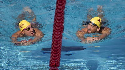 Chase Kalisz, left, and Michael Phelps are training partners at ASU's Mona Plummer Aquatic Center, looking to qualify for the Rio Olympics.