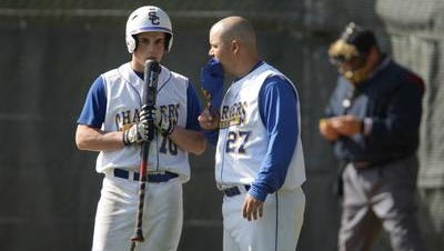 Spotswood coach Glenn Fredricks, right, talks with batter Mike Collins as they play South River in a baseball game played with wood bats Thursday, May 22, 2008 at South River High School.