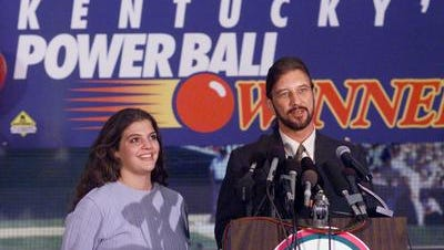 After receiving a ceremonial check at Louisville Slugger Museum, Powerball winner David Edwards, of Westwood, Ky., answered reporters' questions yesterday with fiancee Shawna Maddux at his side. They may move to Las Vegas or Florida.
