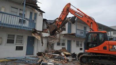 """The demolition of the Thrift Travel Inn in November 2012 is shown The """"thorn"""" for the City of Salisbury for years was being demolished by Demoliton Services of Northern Virginia."""