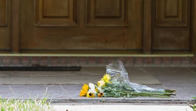 Flowers lay in front of Dan Markel's house in the 2100 block of Trescott Drive.