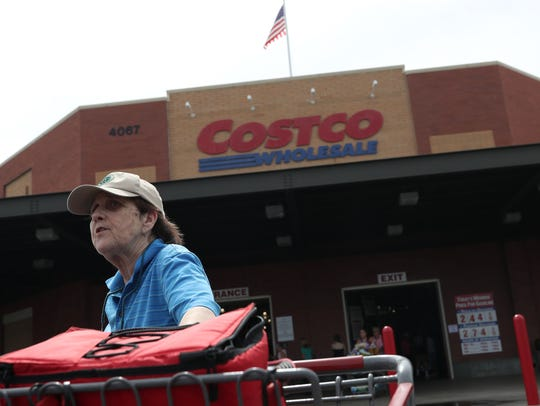 Renee Jouvenas walks out of Costco, where buyers were