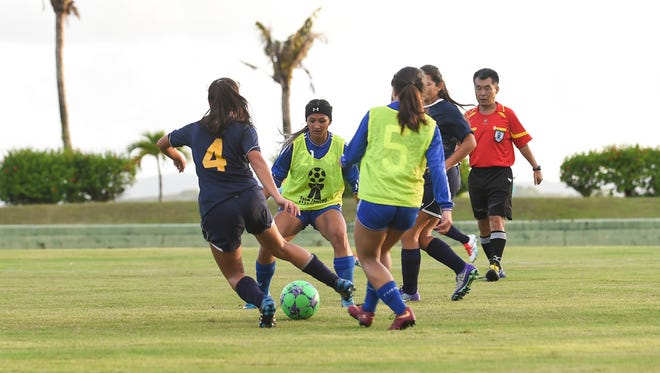 In this file photo the Notre Dame Royals play the Guam High Panthers in abn Independent Interscholastic Athletic Association of Guam Girls' Soccer League match. The Royals face the Bulldogs today in the league's semifinals.