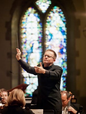 Craig Hella Johnson, leading the Vocal Arts Ensemble and Cincinnati Chamber Orchestra in Bach's B Minor Mass at St. Catharine of Siena in Westwood.