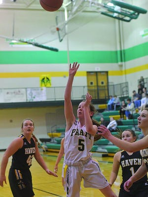 Gabby Gatlin, (#5) a young, upcoming player for the Lady Pratt High School Greenbacks, shoots for 2 in a game at home against Haven.