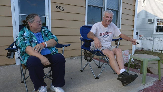"Joe and Tina Dacy set up on their E Street porch to watch Millville High School's season opener against Mainland Regional High School from the back of the north end zone.  The couple has been watching Millville's home games from their porch for 44 season, ""before the field had lights,"" according to Tina Dacy."