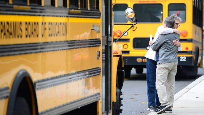Paramus bus drivers hugging at the board of education building before going on their routes on Friday, May 18, 2017. A Paramus bus carrying fifth graders was involved in deadly crash on Thursday that killed a teacher and a student.
