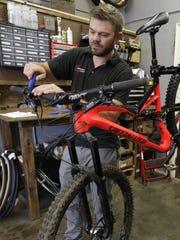 Ben Rennert, owner of Winnebago Bicycle, works on a