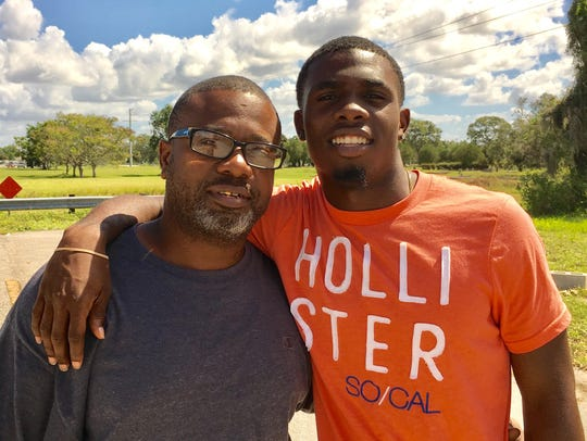 Fort Myers High senior Randy P Smith, with his father,