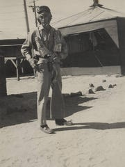 George Wallace wearing his uniform and flight equipment on base during his service in the US Army Air-Forces.
