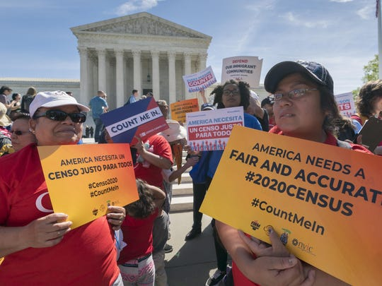 FILE - In this April 23, 2019 file photo, immigration activists rally outside the Supreme Court as the justices hear arguments over the Trump administration's plan to ask about citizenship on the 2020 census, in Washington. A new court filing Thursday, May 30 by lawyers opposing adding the citizenship question to the 2020 census alleges a longtime Republican redistricting expert played a key role in making the change. (AP Photo/J. Scott Applewhite, File)