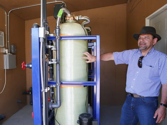 Pueblo Unido Development Organization Executive Director Sergio Carranza talks about the water filtration system at the San Jose Community Center on Thursday, April 16, 2015 in Mecca, Calif.