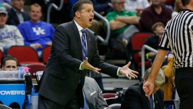 Kentucky head basketball coach John Calipari questions a call against Stony Brook on Thursday, March 17, 2016, at Wells Fargo Arena in Des Moines.