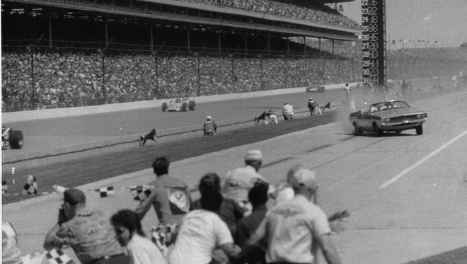 The pace car driven by car dealer Eldon Palmer goes out of control shortly before crashing into a  photographers stand.