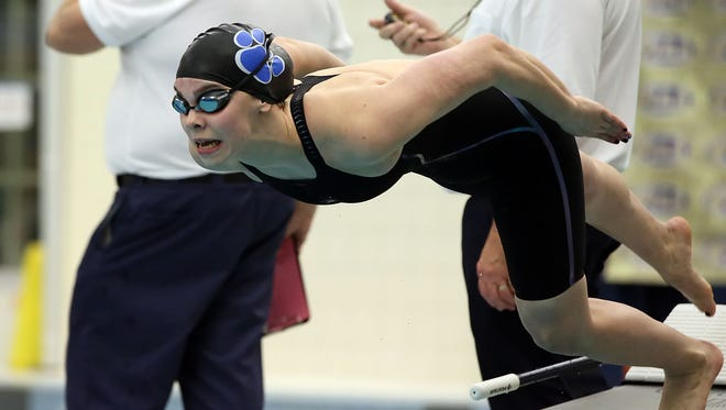Dallastown's Kacey Oberlander, comes off the blocks to swim the 200-yard IM during the PIAA swimming and diving championships in March. Oberlander is one of several York YMCA swimmers who qualified for next week's U.S. Olympic Team Trials.