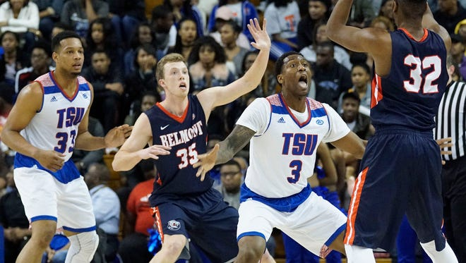 Belmont's Evan Bradds (35) battles with Tennessee State's Jordan Reed (3) for position as Amanza Egekeze (32) looks to pass.