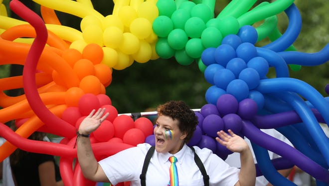 Ivaliss Correa helps lead the 2016 Gay Pride Parade on Park Ave. Saturday.