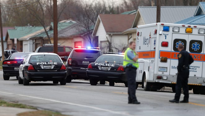 Police take a man into custody from a car in the driveway of a house off Fort Avenue after he mad threats to harm himself and his children on Wednesday, March 9, 2016. Traffic was blocked for about an hour while police resolved the situation.