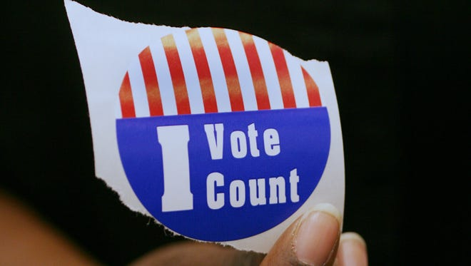 A voter showed the sticker she received from election workers at the Marion County clerk's office in 2008.