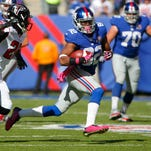 Giants wide receiver Rueben Randle (82) turns up field after a reception against the Atlanta Falcons during the first half on Sunday at MetLife Stadium in East Rutherford.