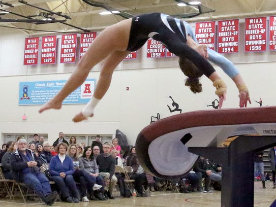 Arrowhead's Alexis Woida competes in vault during a