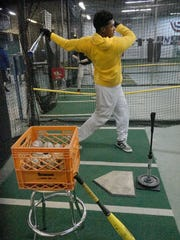 Freshman Jordan Pressley lets loose in the batters cage. He is one of the Ocelots' potential power hitters.