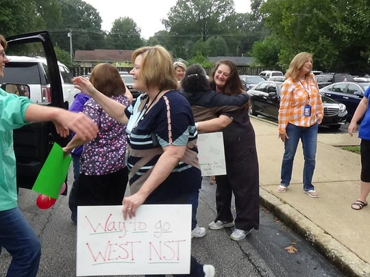 Friends and family gathered at the West Tennessee Regional Public Health Building to welcome home Sheila Benson, Mica Rudd, Gwen Blayde, Jennifer Cook, Kristie Threet, and Lisa Brandon after their return from North Carolina, Wednesday, September 26, after volunteering to help in the recovery efforts after Hurricane Florence.
