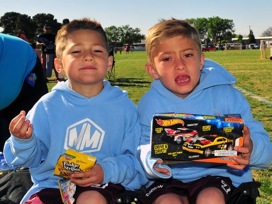Derek, 7, left, and his brother John David, 8, members of the Mighty Minions soccer team,  enjoy a snack and playtime after one of the team's soccer games Saturday, April 16, at the Provencio Van Dam soccer fields in Las Cruces.