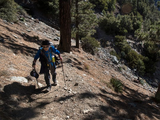 Sam Kim hikes a trail up to Mt. Baldy, a trek he has made more than 700 times. (Brian van der Brug/Los Angeles Times/TNS)