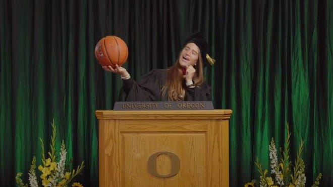 "Sabrina Ionescu sings to her basketball while dancing to ""Shout"" at the end of University of Oregon's virtual commencement ceremony on Saturday."