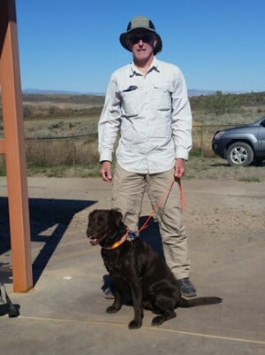 Marty Bannon poses with his dog Kona before departing on his five-month, 3,100-mile hike of the Continental Divide Trail.