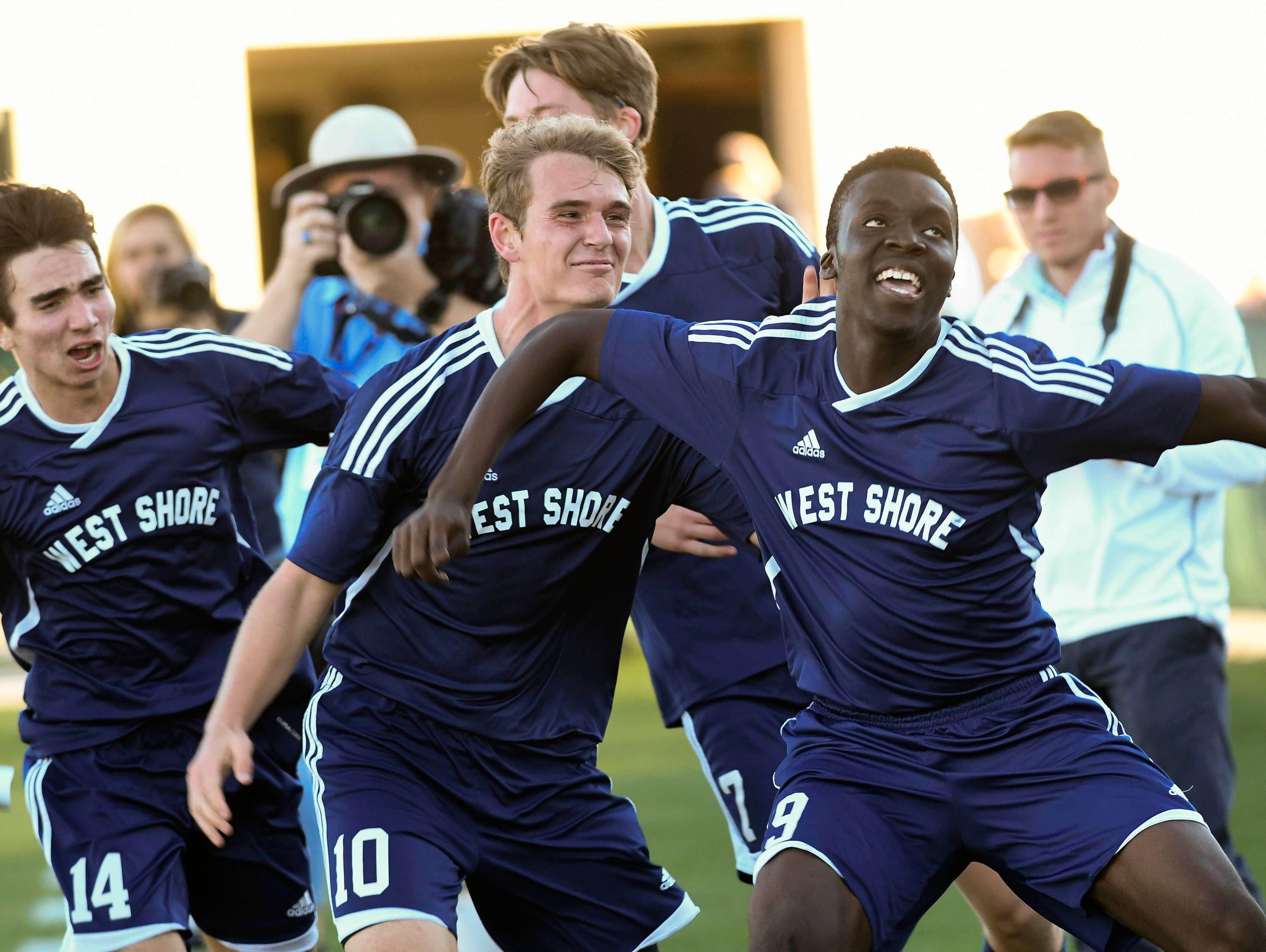 West Shore players celebrate the game winning goal by Amugo Chukwunenye (19) during Thursday's Class 2A championship in Deland.
