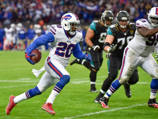 Oct 25, 2015; London, United Kingdom;  Buffalo Bills free safety Corey Graham (20)  runs in for a touchdown during the second half of the game between the Jacksonville Jaguars and the Buffalo Bills at Wembley Stadium. Mandatory Credit: Steve Flynn-USA TODAY Sports