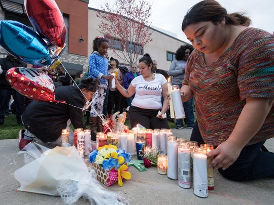 Family and friends of Jontell Reedom gather on Tuesday, March 13, 2018 along Cross Avenue near the place where he had an altercation with Tulare Police on Monday. Reedom, a standout athlete at Tulare Union in 2008, died from gunshots he received during the struggle.