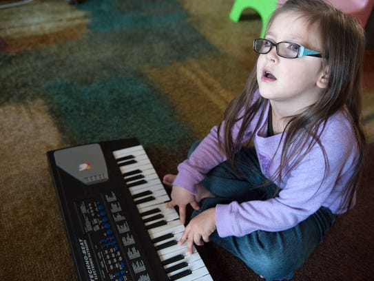 """Remington Hedrick plays a keyboard and sings """"Twinkle,"""
