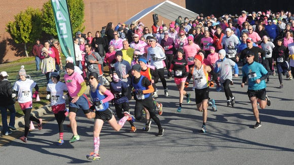 Runners take part in a past Power of Pink 5K in Haywood