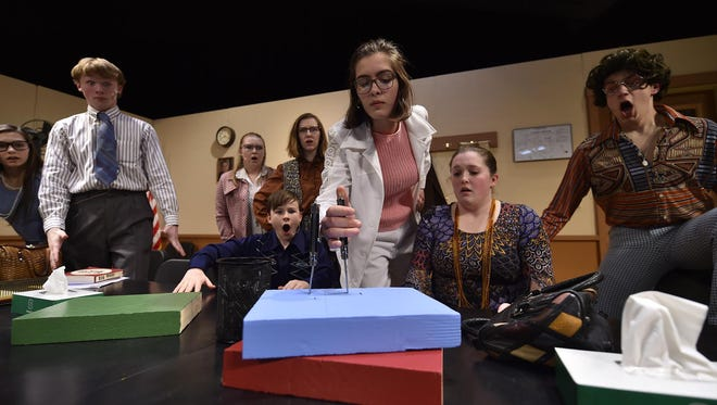 """Jurors react after Juror No. 8, played by Natalie Meikle, proves a point with a knife in a scene from the Sevastopol School production of """"12 Angry Jurors."""" Also shown are cast members, from left, Lexie Henkel, Gavin Andersson, Emma Schleicher, Lizzy Fiscus, Kaitlyn Schauske and Bennett Rabach."""