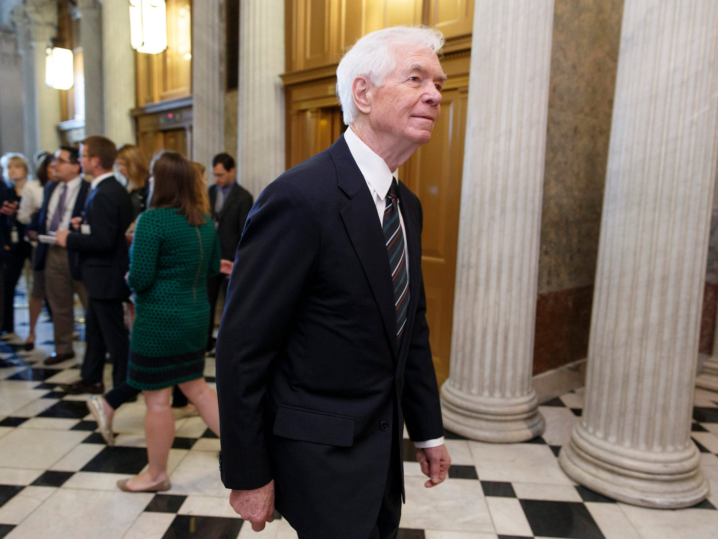 Sen. Thad Cochran, R-Miss., arrives at the Senate chamber