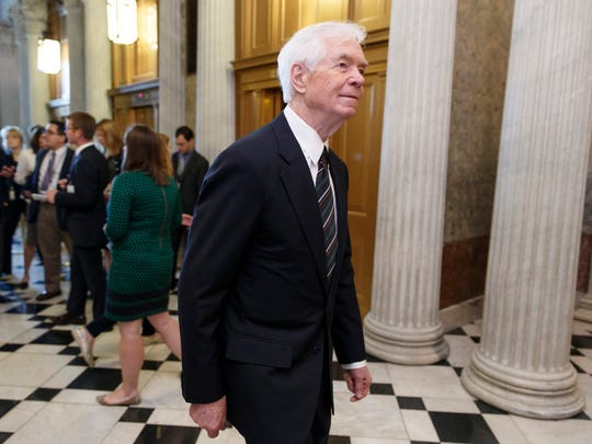 Sen. Thad Cochran, R-Miss., arrives at the Senate chamber for a vote in 2014.
